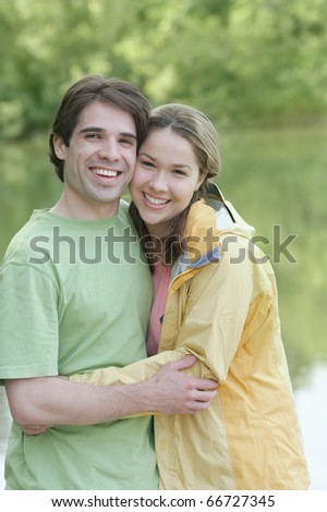Young couple embracing outside - stock photo