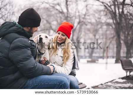 Young couple enjoy in park with his dog