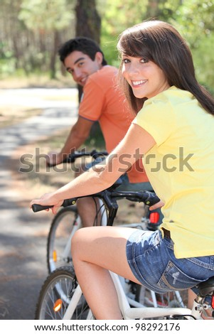 Young couple enjoying bike ride together - stock photo