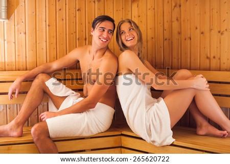 Young couple enjoying in sauna - stock photo