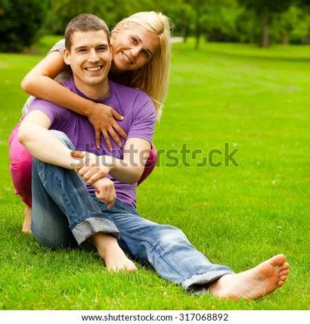 Young couple enjoying in the park on a summer day. - stock photo