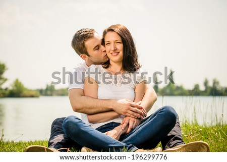 Young couple enjoying life together in nature on suuny day - stock photo