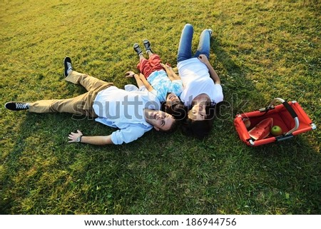 Young couple enjoying love on summer meadow - stock photo