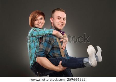 Young Couple Enjoying Piggyback Ride - stock photo
