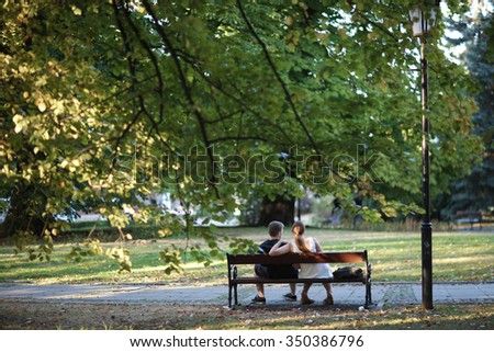 Young couple enjoying summer in the city park