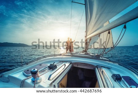 Young couple enjoying sunset on the yacht in Andaman sea - stock photo