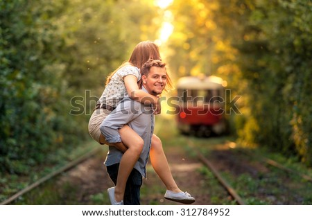 Young couple enjoying togetherness on the city park. - stock photo