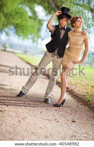Young couple fashion. Standing at the summer rain. - stock photo