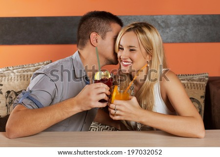 Young couple flirting in a night club. - stock photo