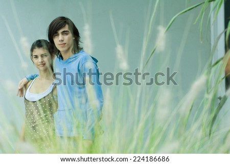 Young couple, focus on background