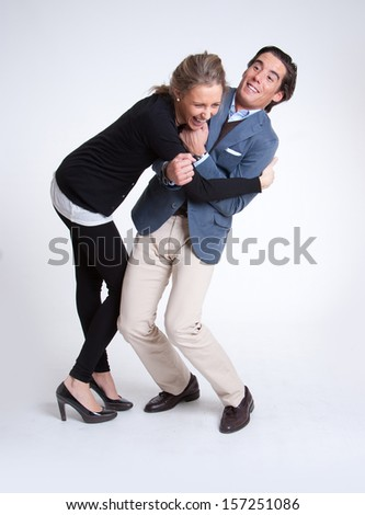 Young couple fooling around - stock photo