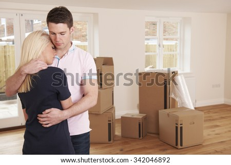Young Couple Forced To Sell Home Through Financial Problems - stock photo
