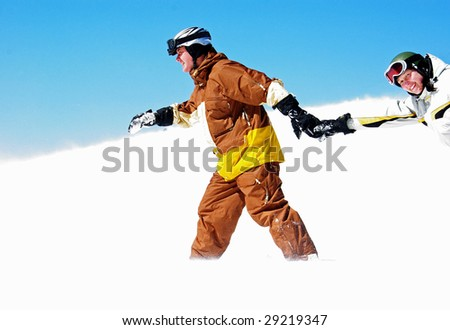 Young couple funning in the ski resort - stock photo