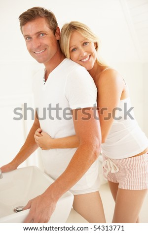Young Couple Getting Ready In Bathroom - stock photo