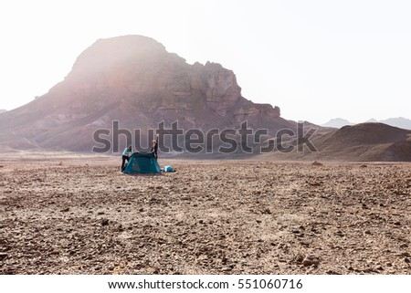 Young couple girls camping morning tent desert mountain waving hello, Negev travel Israel nature tourism.