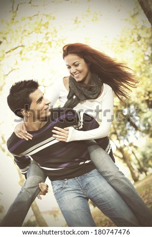 Young couple having a good time together at the park  - stock photo