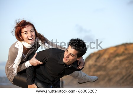 Young couple having a good time together (selective focus with shallow DOF) - stock photo