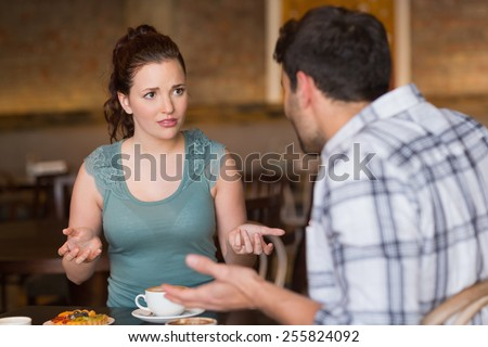 Young couple having an argument at the cafe - stock photo
