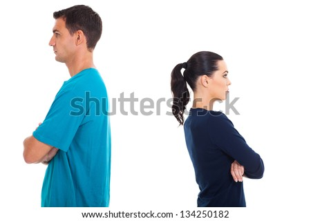 young couple having argument and turning their back on each other - stock photo