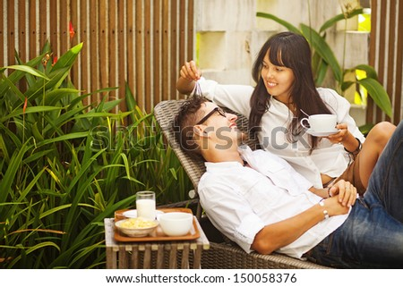 young couple having breakfast together - stock photo