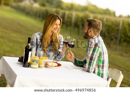 Young couple having dinner at vineyard countryside