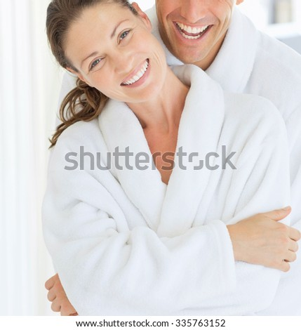 Young couple having fun in bedroom