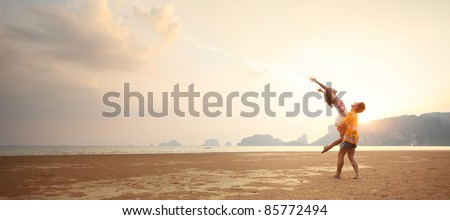 Young couple having fun on a sandy coast