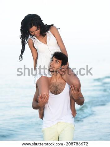 Young couple having fun on the beach - stock photo
