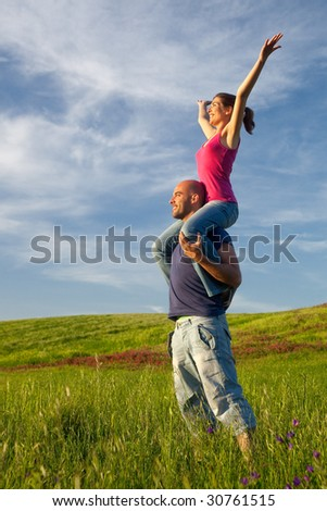 Young couple having good time on a beautiful springfield - stock photo