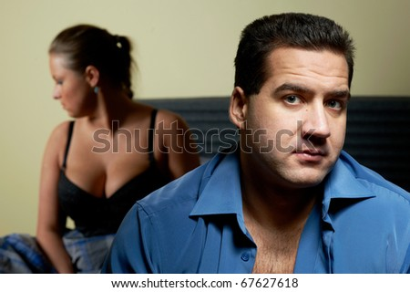 Young couple having relationship problems, in bedroom - stock photo