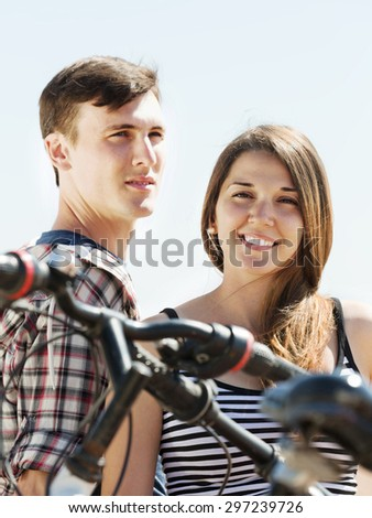 Young couple having rest after cycling