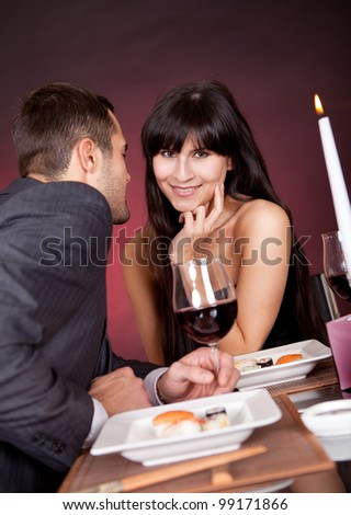 Young couple having romantic conversation at restaurant - stock photo