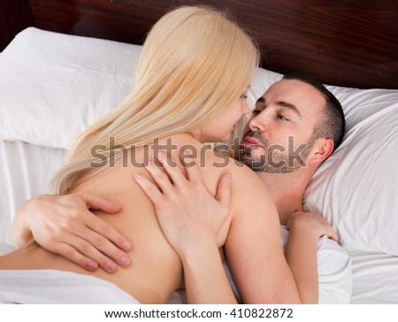 Young couple having sex in comfortable family bed  - stock photo