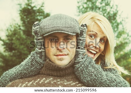 Young couple having some fun on a autumn day - stock photo