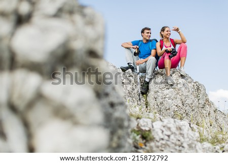 Young couple hiking on the mountain - stock photo