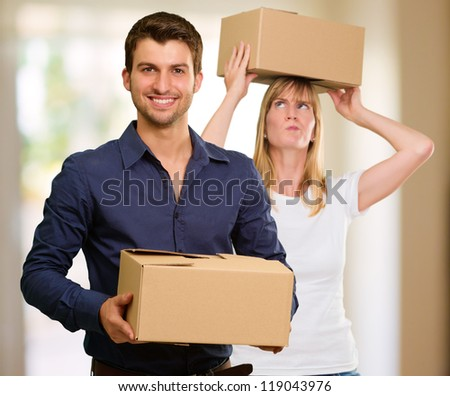 Young Couple Holding Cardboard Box - stock photo