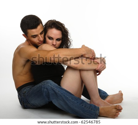 young couple holding each other with affection, isolated on white - stock photo
