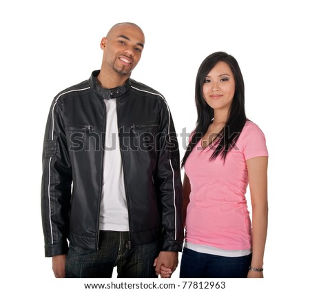 Young couple holding hands - African American guy with Asian girlfriend. - stock photo