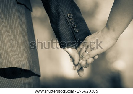 Young couple holding hands after weeding ceremony