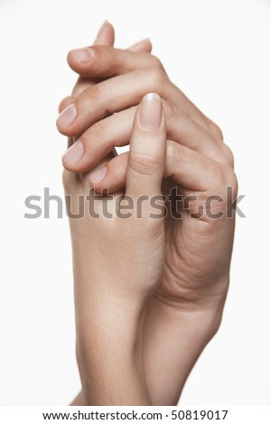 Young couple holding hands, arms raised together, close-up on hands - stock photo