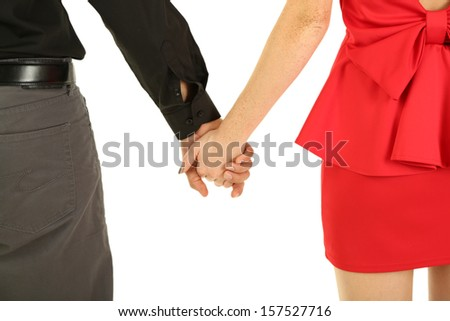 Young couple holding hands isolated on white - stock photo