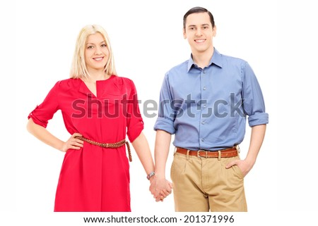 Young couple holding hands isolated on white background - stock photo