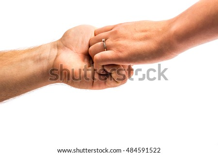 Young couple holding hands on white background