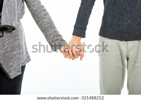Young Couple Holding Hands Over White Background
