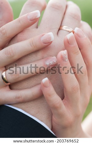 Young couple holding hands tightly