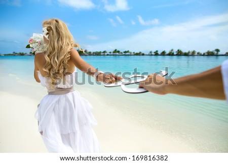 Young couple honeymoon on Maldives - stock photo