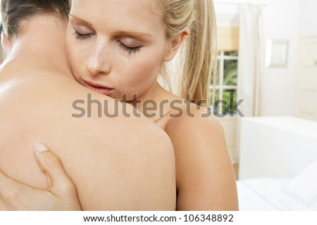 Young couple hugging and kissing with their eyes closed. - stock photo
