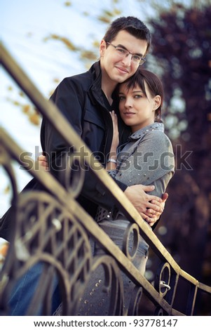Young couple hugging in the autumn park - stock photo