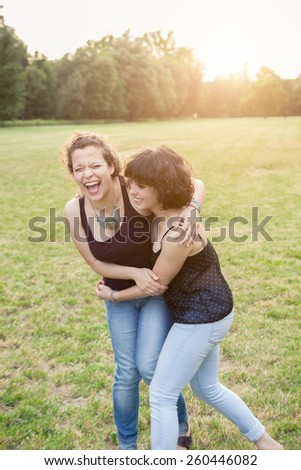 Young couple hugging in the park - stock photo