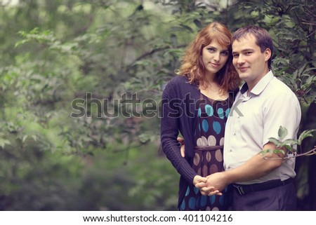 Young couple hugging in the park summer - stock photo